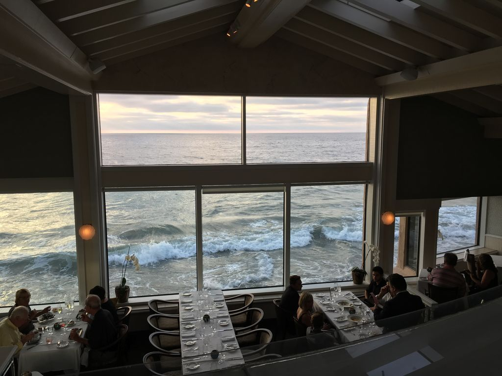Waves hit the windows during dinner at The Marine Room