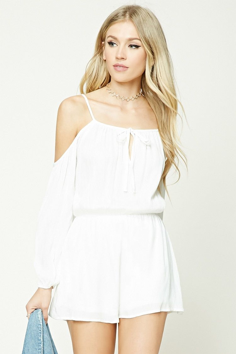A woven gauze romper featuring an open-shoulder design, self-tie front with keyhole cutout, and elasticized long sleeves and waist.