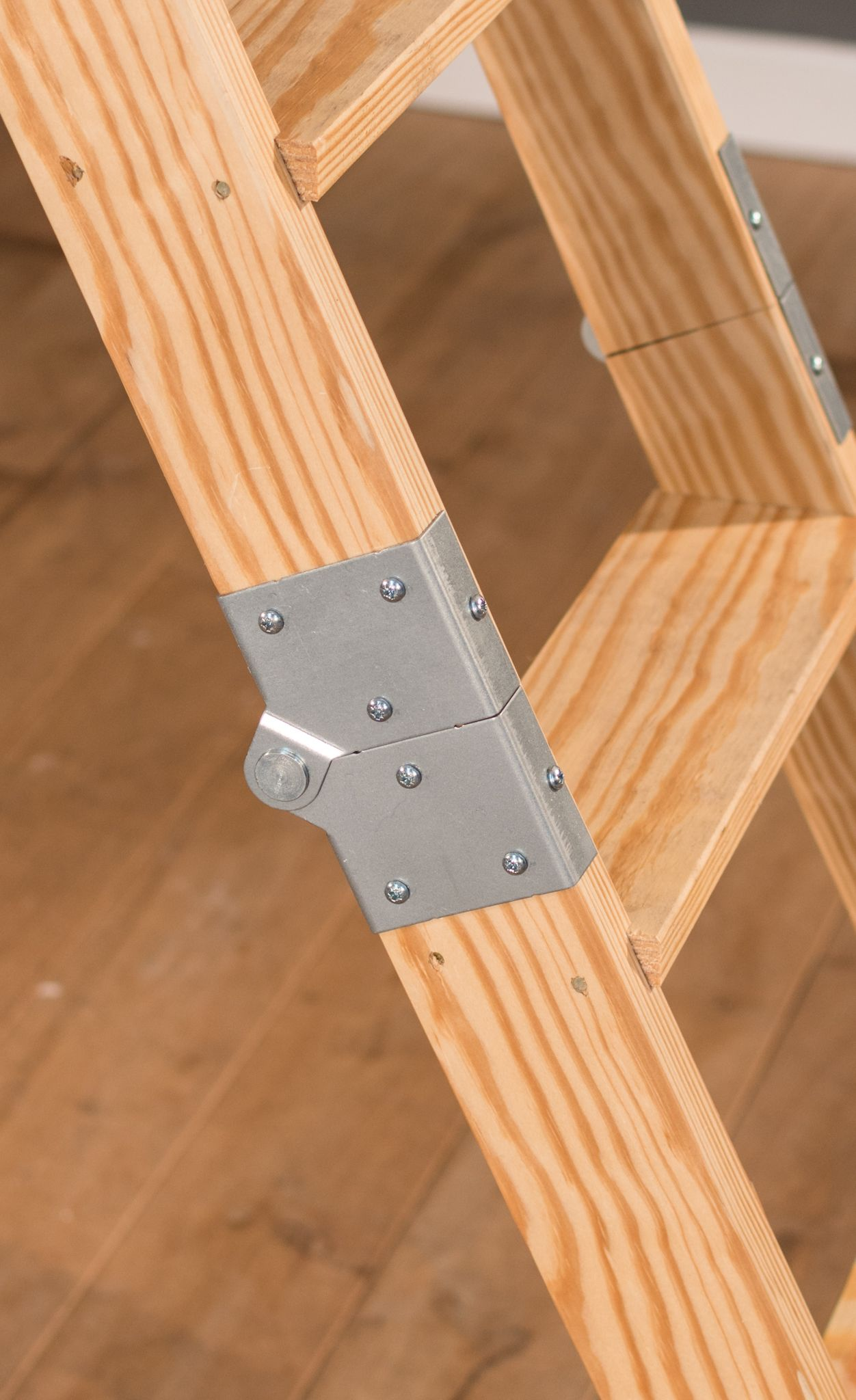 The Stira Wraparound Hinge Clamps To 3 Sides Of The Ladder The Fold Between The Bottom And Middle Sections Of A Loft L Folding Attic Stairs Loft Ladder Ladder