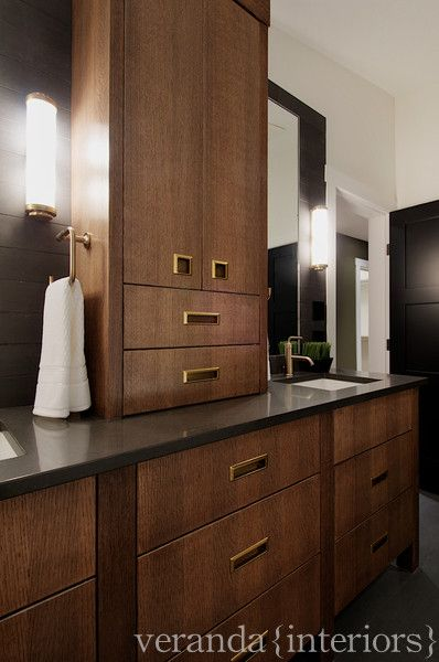 Contemporary Bathroom Design With Brushed Gold Hardware And Faucets. Dark  Maple Cabinets, Gray, Countertops And Charcoal Accent Wall.