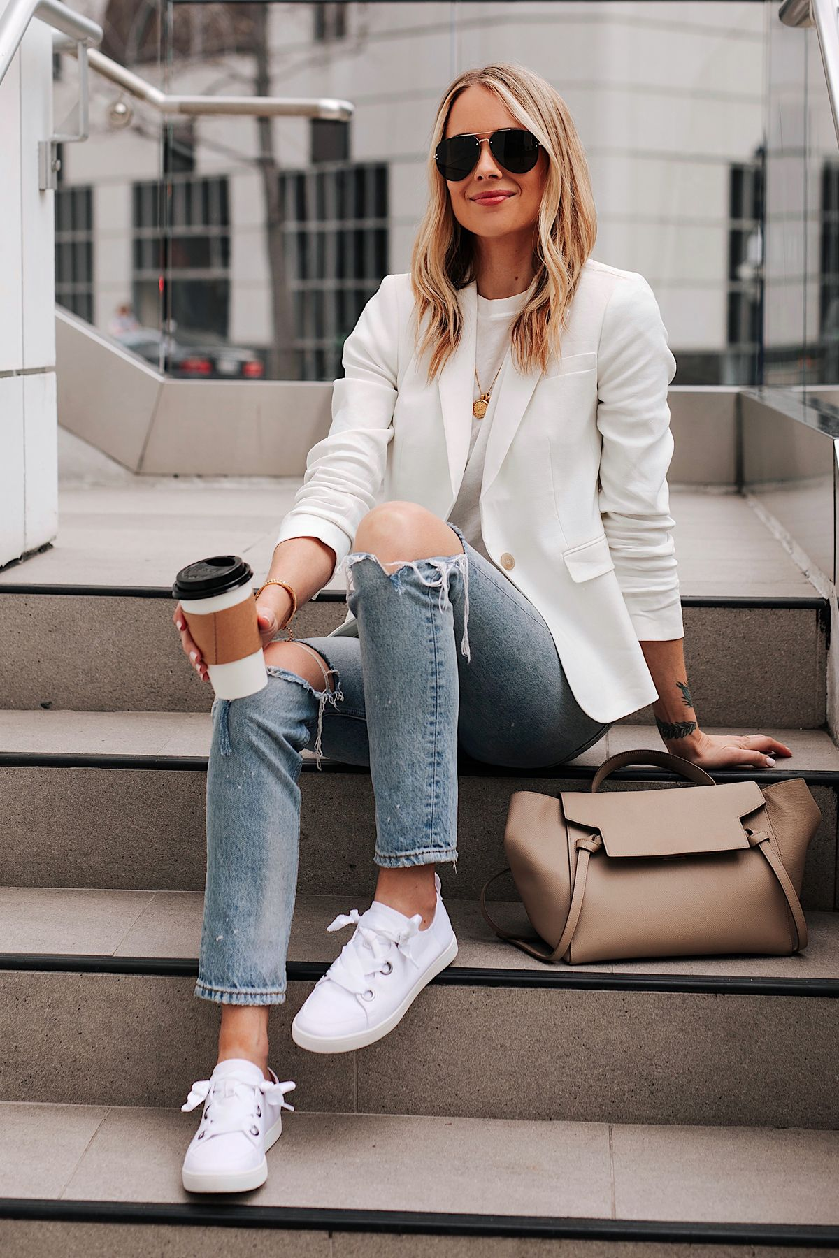 Fashion Jackson Wearing White Blazer