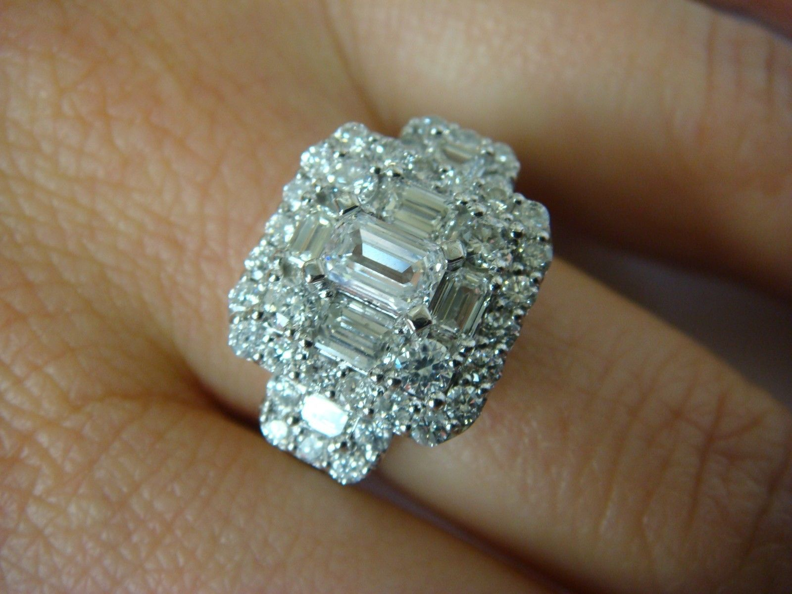 Emerald and radiant cut diamonds in k white gold solitaire