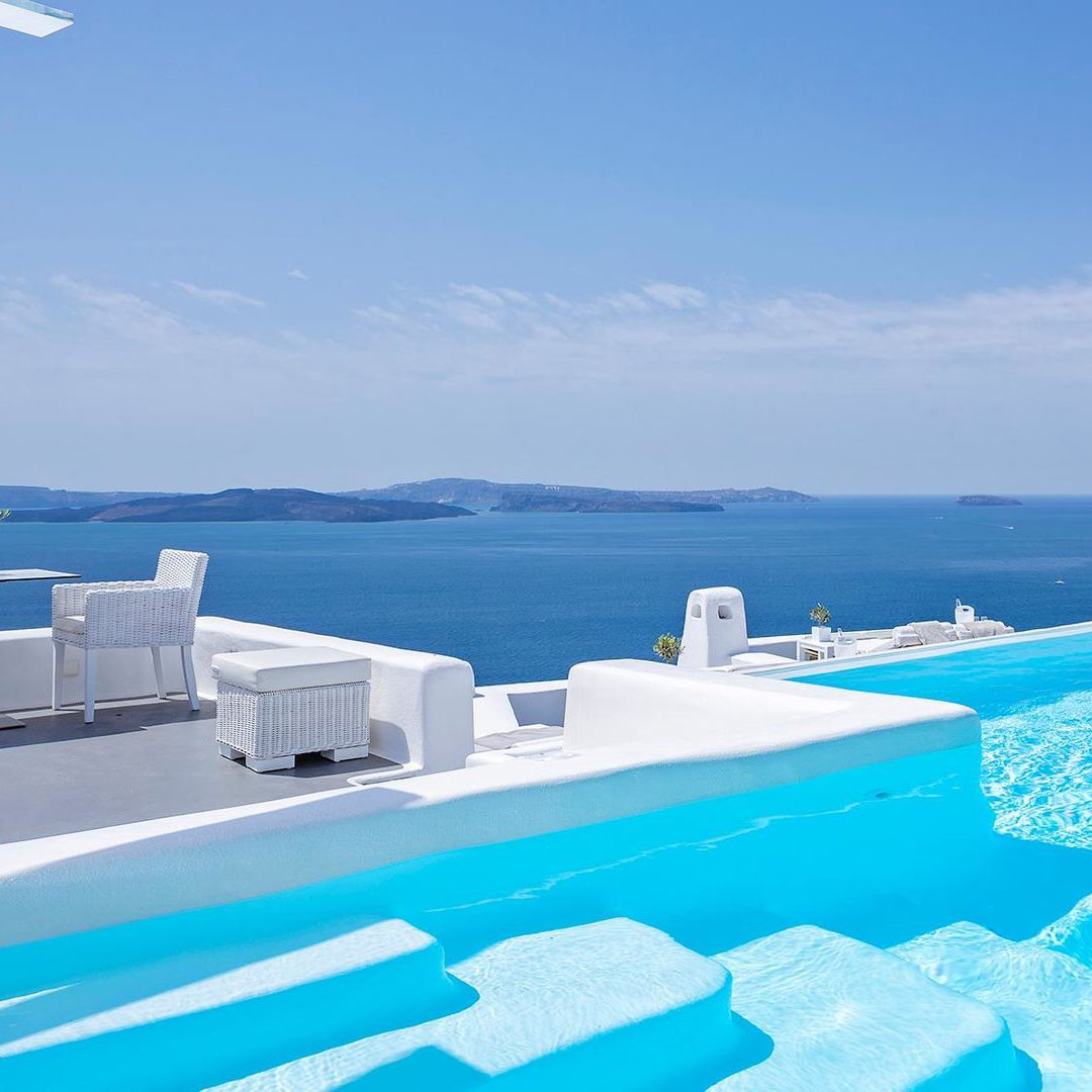 Rooftop Swimming Pool With Cool Ocean View Located In Santorini