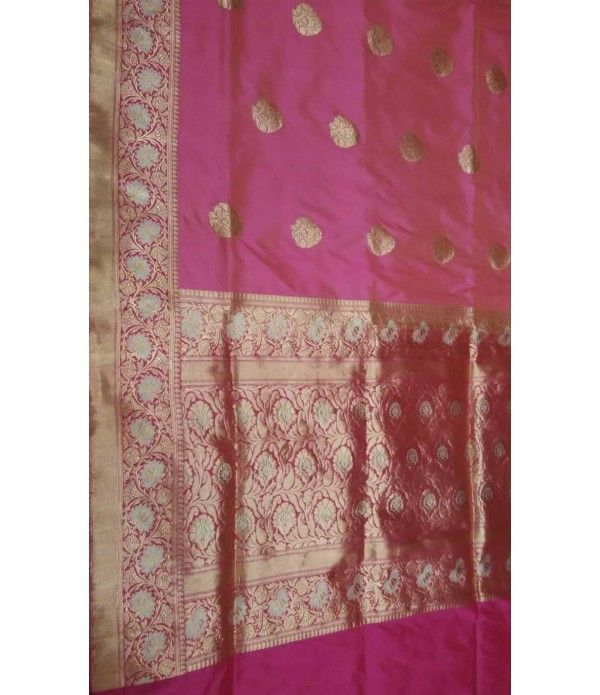 Pink Banarasi Handloom Katan Soft Silk Saree--------------------------------------------------------------Let everyone at the party, bedazzled with this grandeur piece of banarasi handloom katan soft silk saree in pink. The saree has a golden pretty designed border as a highlight. What more can beautify you for perfection! -------------------Sarees from Luxurionworld