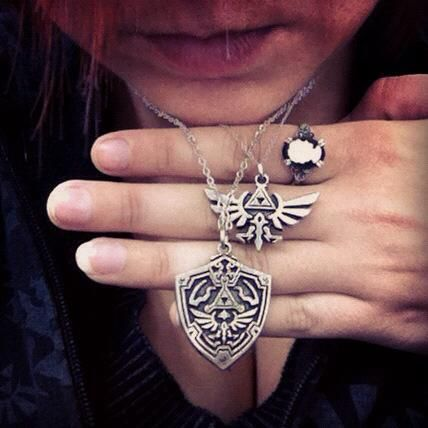 Hylian Crest and Shield necklaces.