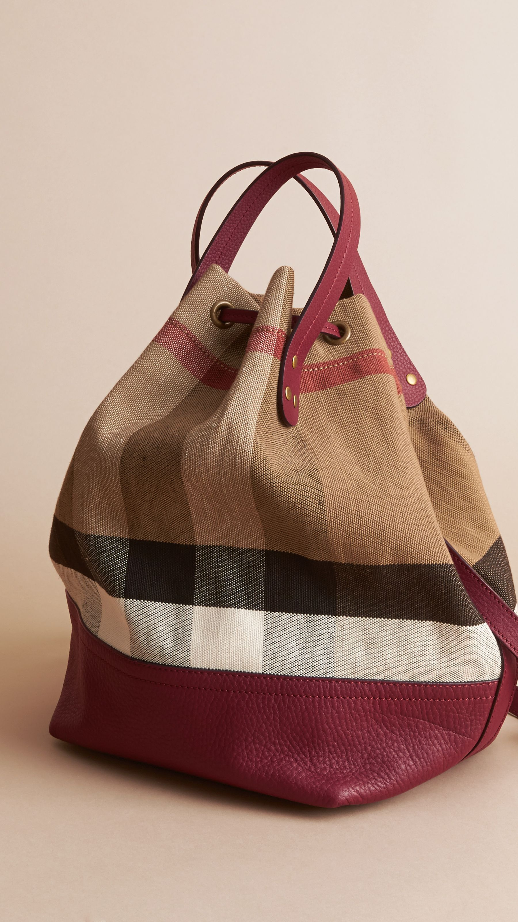 cbc757a5e1bf Medium Canvas Check and Leather Bucket Bag in Burgundy Red - Women