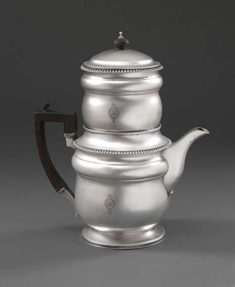 Emes & Barnard - A George III Coffee Percolator A George III Coffee Percolator Artist Biography: Apprenticed to Charles Wright in 1781 and turned over to Thomas Chawner in 1784, Edward Barnard I became Chawner's foreman in 1786. He became free of the Goldsmiths' Company in 1789 and in 1808 entered his mark in partnership with Rebeccah Emes. Becoming one of the most successful establishments in London, Emes and Barnard acted primarily as retailers