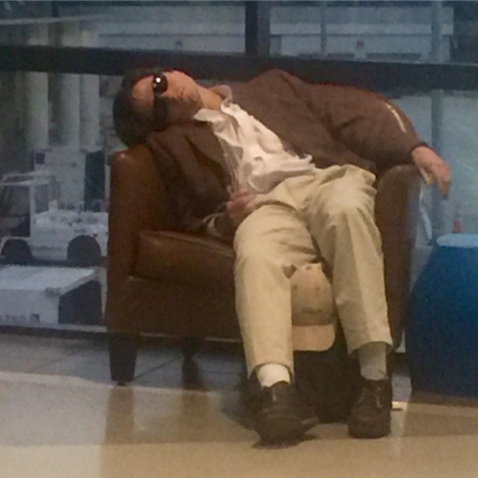 This guy at the Philadelphia Airport is sleeping full Weekend at Bernie's style.
