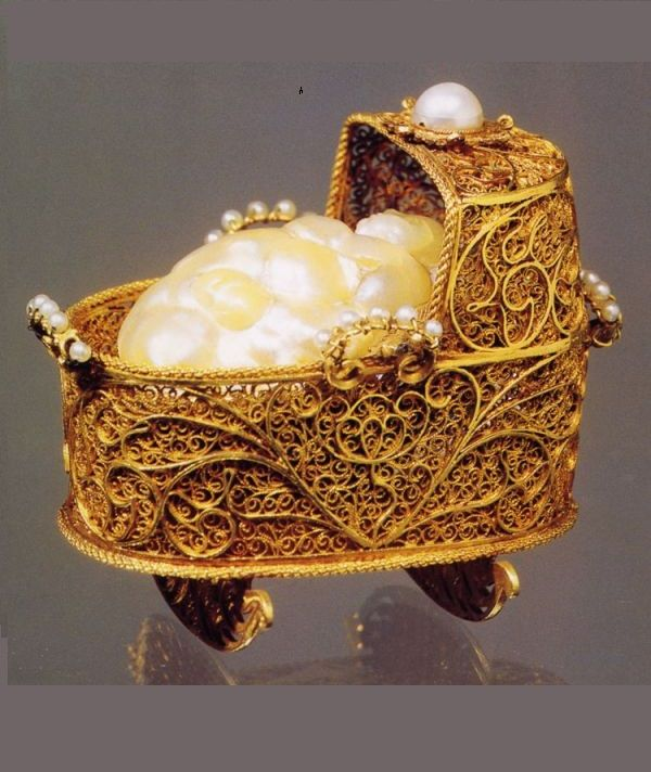 A gold, enamel, diamond, pearl and silk cradle, c.1695, given to Anne-Marie Luisa, princess Palatine, by her husband on learning of her pregnancy, sadly, she miscarried, and the Medici line ended.