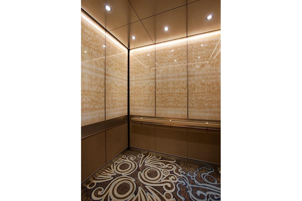 LEVELe105 Elevator Interior with upper panels in ViviStone Honey