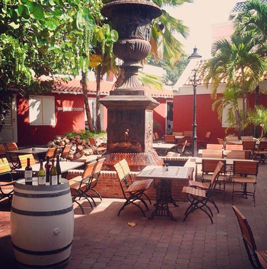 you can have your dinner in the terrace if you like your privacy,,, and enjoy of the decor of going back in the past of Curacao