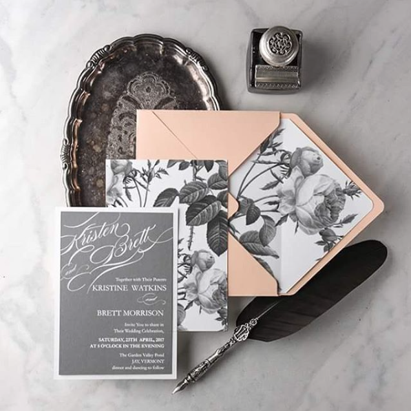 White grey and peach invites with a lovely floral print envelope