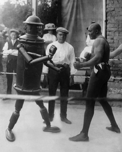 "Jack Johnson battles the Victorian-era robot ""Boilerplate."", ca 1910's"