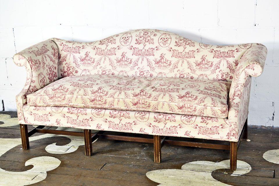 Vintage camelback sofa on straight wood legs with simple