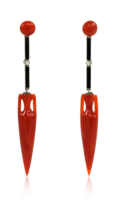 A pair of Art Deco earrings comprised of a coral button top and an onyx and diamond segment terminating in a carved coral amphora pendant, platinum. France. Circa: 1920