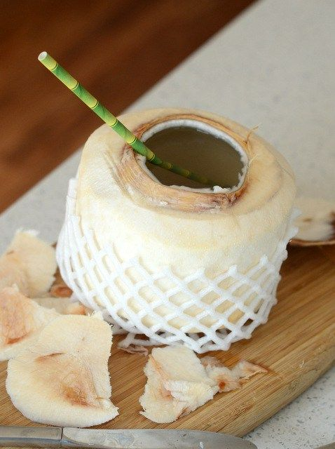 How To Easily Open A Young Coconut Modern Tiki Tiki Coconut Coconutwater Coconut Coconut Health Benefits Food