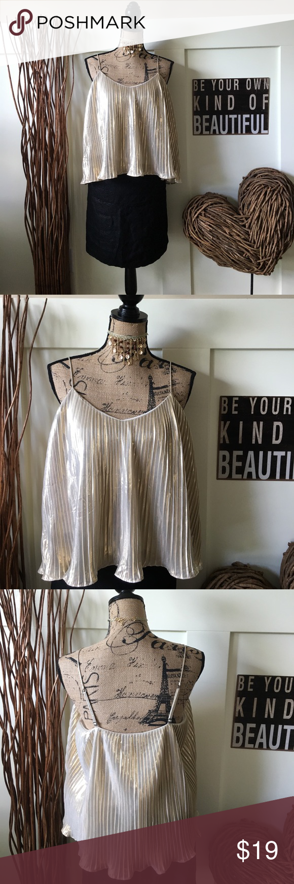 Abercrombie & Fitch gold metallic crop top Pleated  metallic crop top has adjustable straps lined and is lined with a layer of cream fabric. Looks so pretty dressed up with your favorite skirt or dressed down with shorts and flip flops. Abercrombie & Fitch Tops Crop Tops