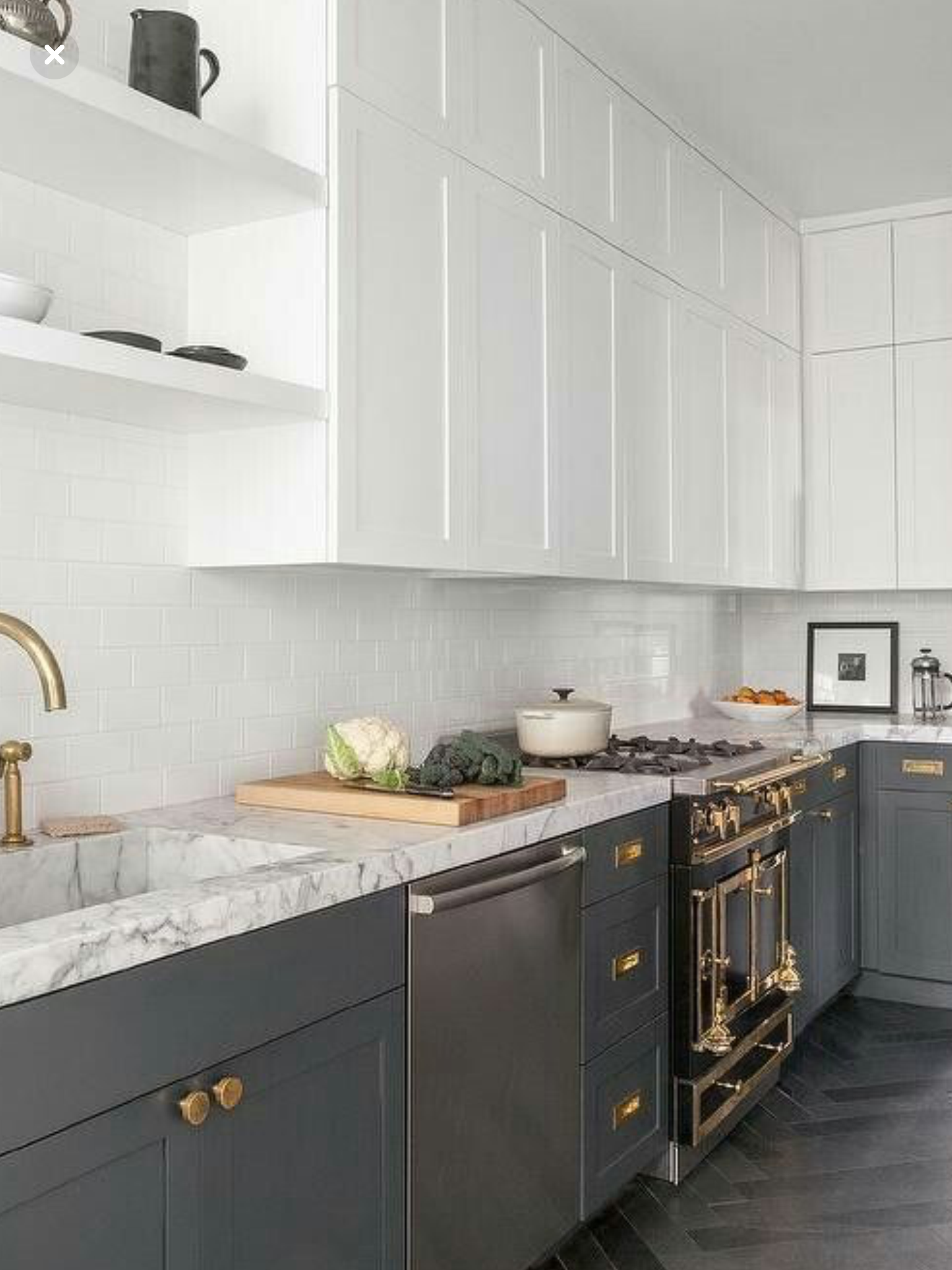 Two tone cabinets white counter tops gold open shelving subway