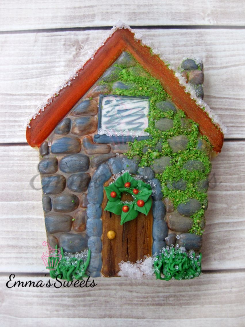 Cobblestone house with moss handpainted cookie