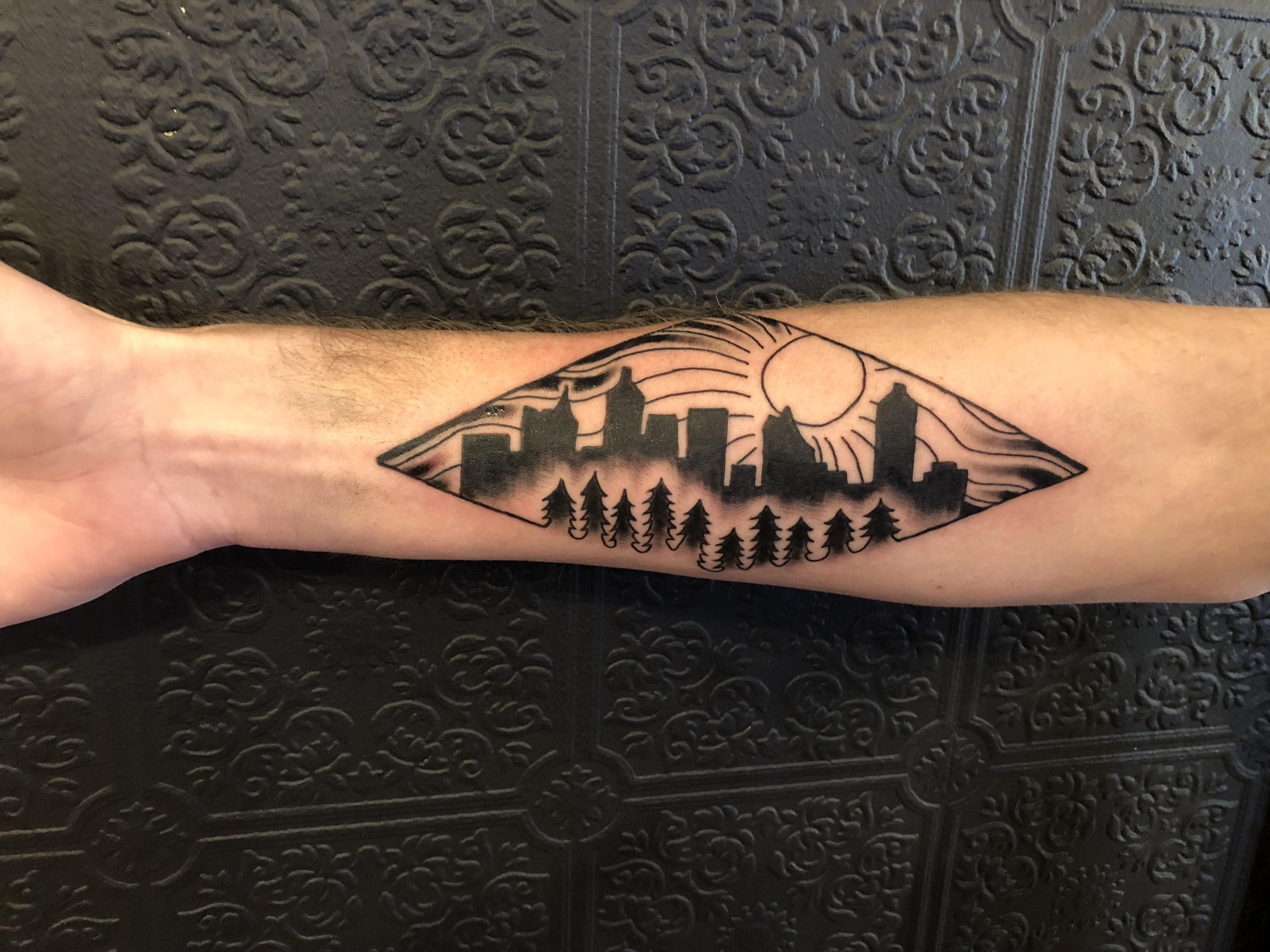 City skyline (Atlanta) among the wilderness tattooed by Britt at ...