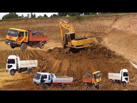 Excavator digging deep hole | Cat excavator loading dump truck | Best he...
