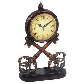 """Metal table clock with a skeleton key-inspired base.  Product: Table clockConstruction Material: MetalColor: BronzeAccommodates: (1) AA Battery - not includedDimensions: 13.5"""" H x 8.75"""" W x 4"""" DCleaning and Care: Wipe with damp cloth"""