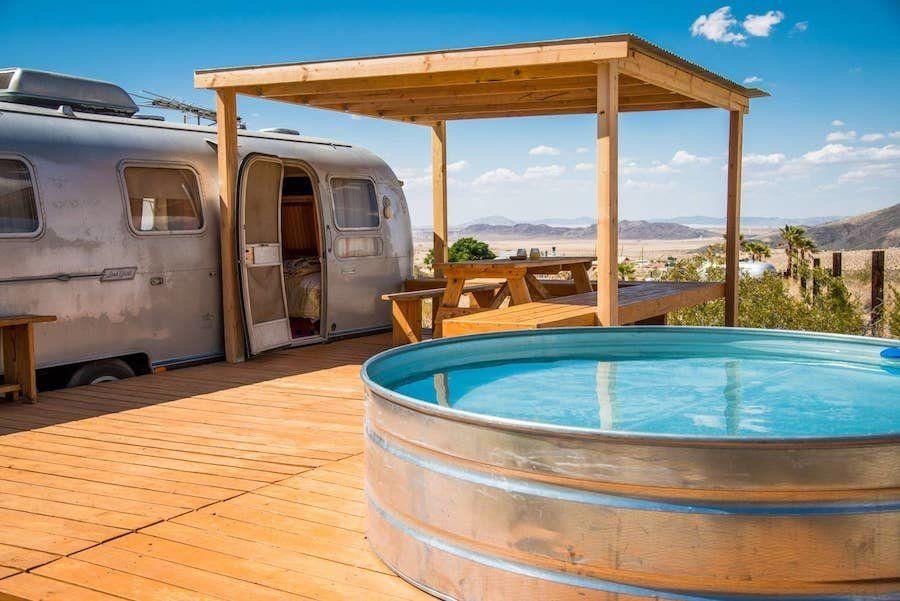 Chloe saraceni vintage camper hot tub outdoor stock