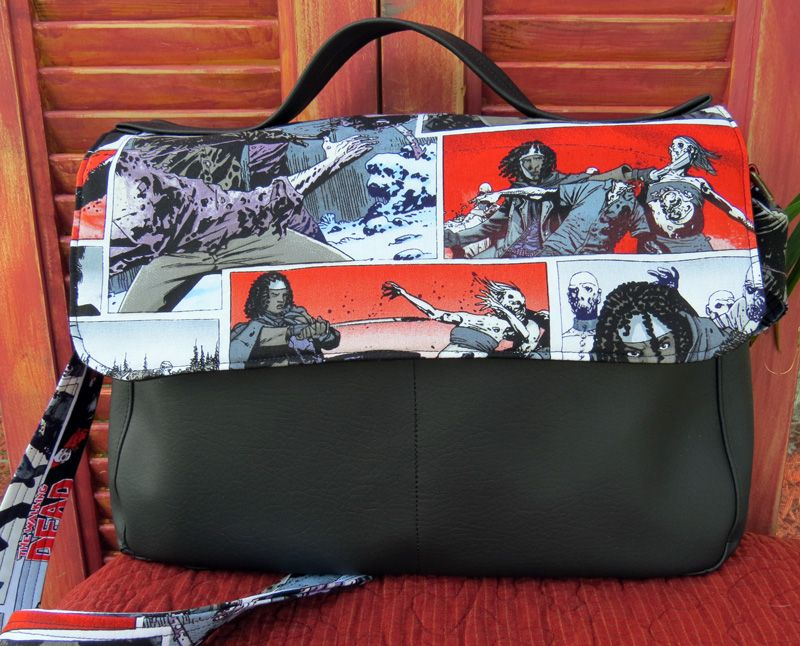 """A classic messenger designed to fit your everyday necessities. Flap enclosure showcases the fabric and has two magnetic clips to keep it closed. Designed to fit a 13"""" laptop and any of the tablets perfectly, it includes 4 open pockets - two on the outside in the front and two on the inside. It also includes a large zippered pocket on the inside. Features both a long adjustable strap and a top handle for those grab-and-go moments."""