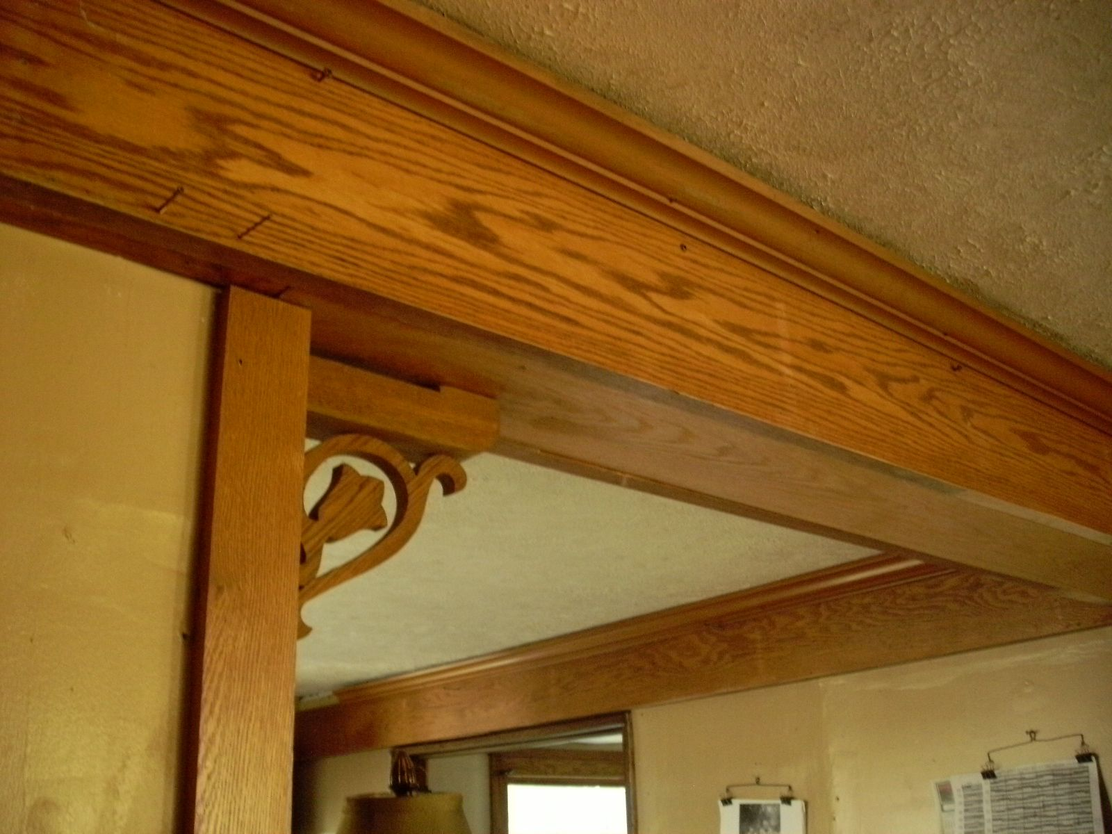 (1) 100 ' thick oak shelves from restaurant - found at Salem Ohio Restore made into kitchen beams - (2) decorative pieces once a quilt frame base found at Salem Restore $7 - cut in half - made 4 corbals. - Crown molding $1 per 16' length  - finishing touch - work still in progress...