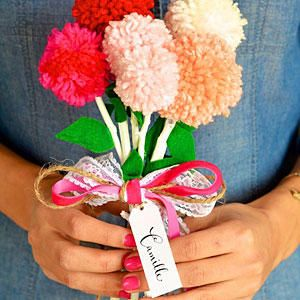 Pom Pom Bouquet - Valentine's Day Crafts We Love - Southernliving. Why buy a bouquet of flowers when you can make your own? We think these pompom blossoms are just as charming!  Get the how-to at Camille Styles
