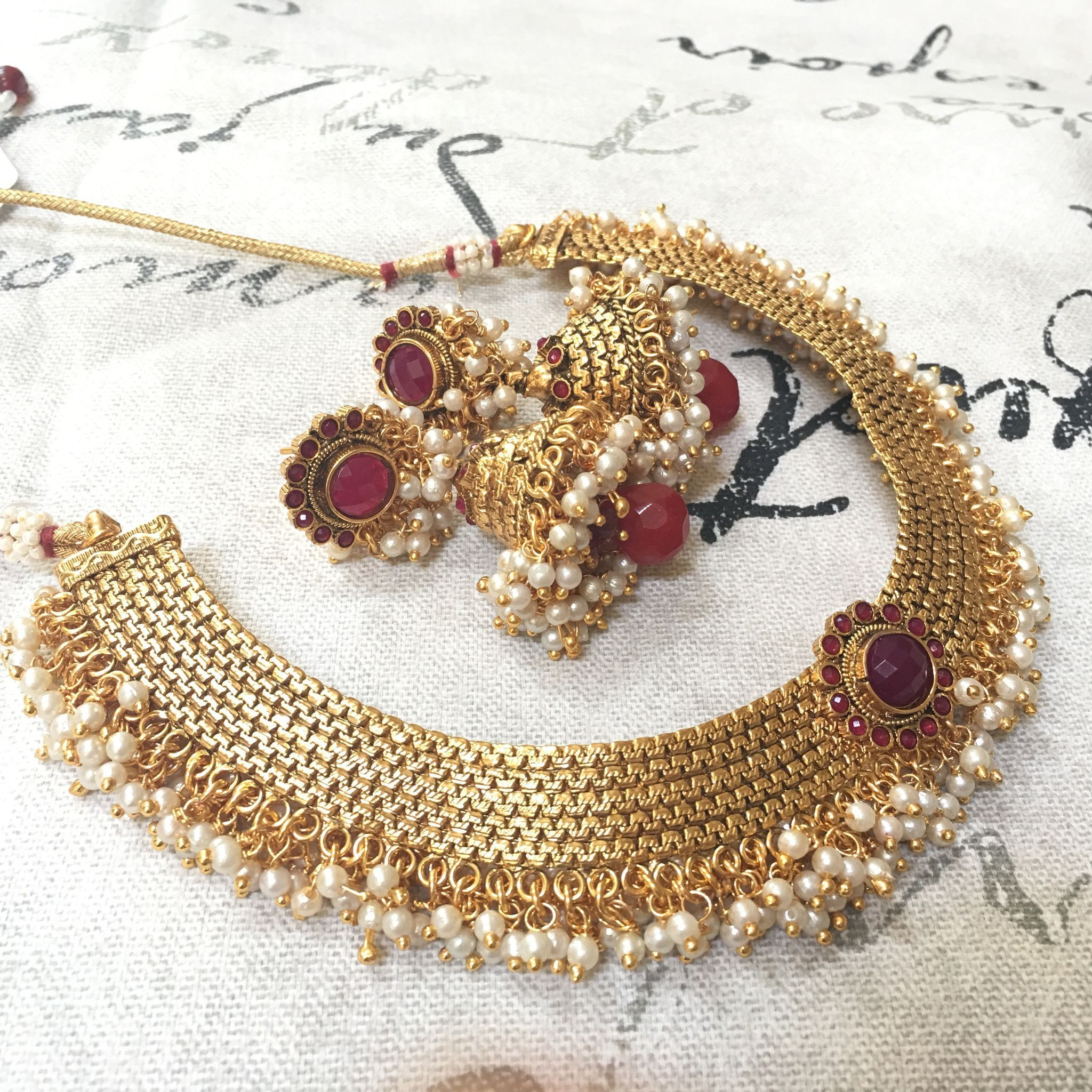 Golden fit necklace with moti and colored center flower indian and