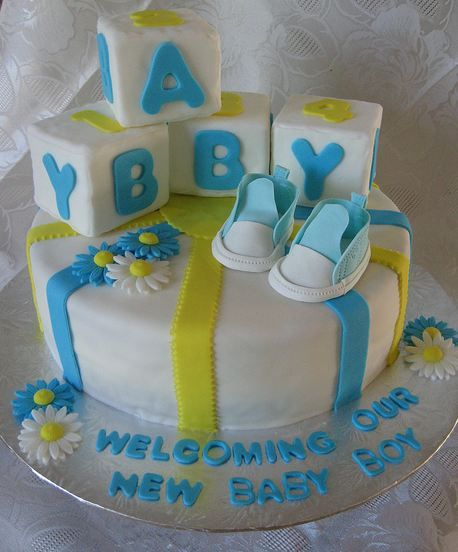 white round baby boy shower cake with baby blocks and shoes on top, Baby shower invitation
