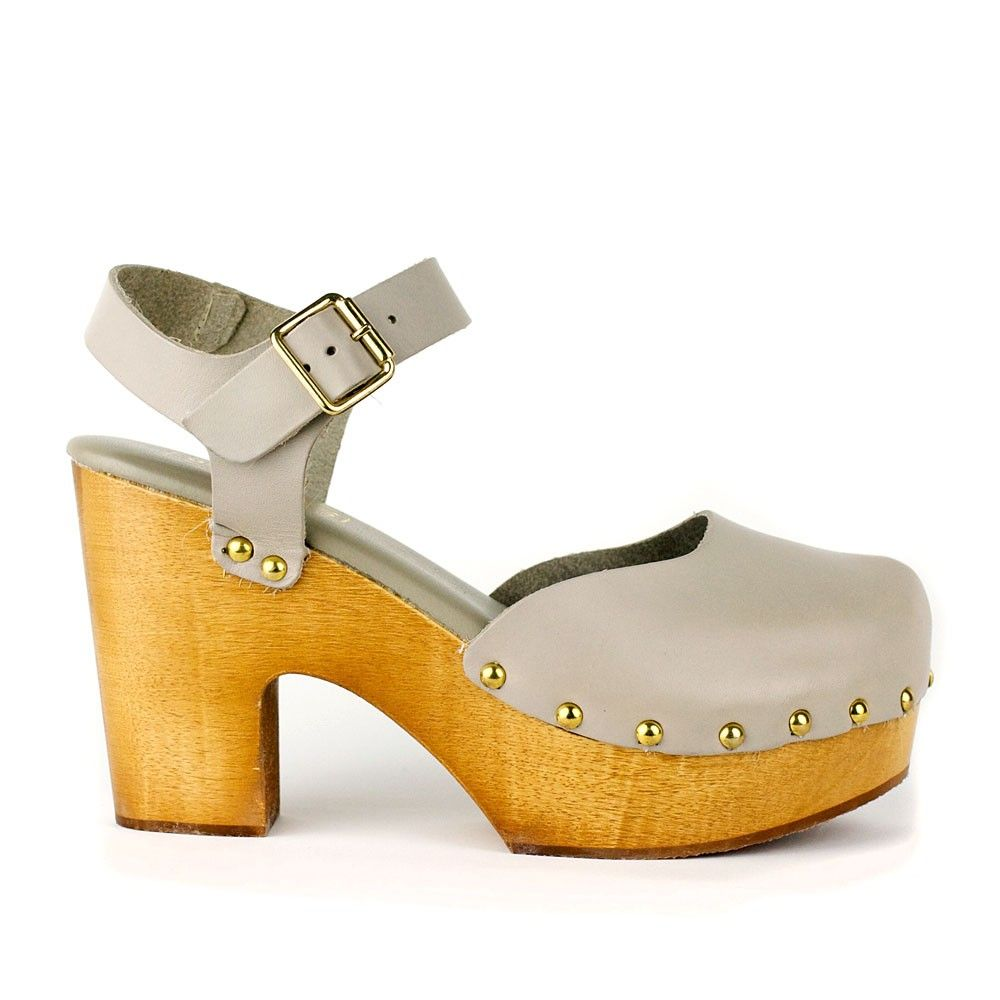 """Our mary-jane style clog """"Tilda"""" is an exclusive item for re-souL. Made of traditional lightweight wood, this style adds height but still lets you strut in comfort. Our 5mm leather padded sock cushions your feet  as you walk. Brass buckle and tacks add the finishing touches to this traditional yet modern silhouette. Wear with dresses, wide leg jeans and culottes.  Would look great in cooler weather with cute socks or patterned tights.   on sale - original price $178.00"""
