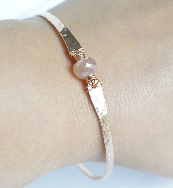 This mystic pearl blush pink moonstone bangle bracelet features