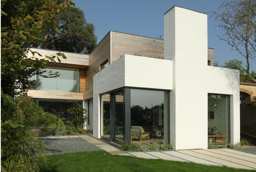 White Brick And Scandi Wood House Gravel And Cement Slab Pathways
