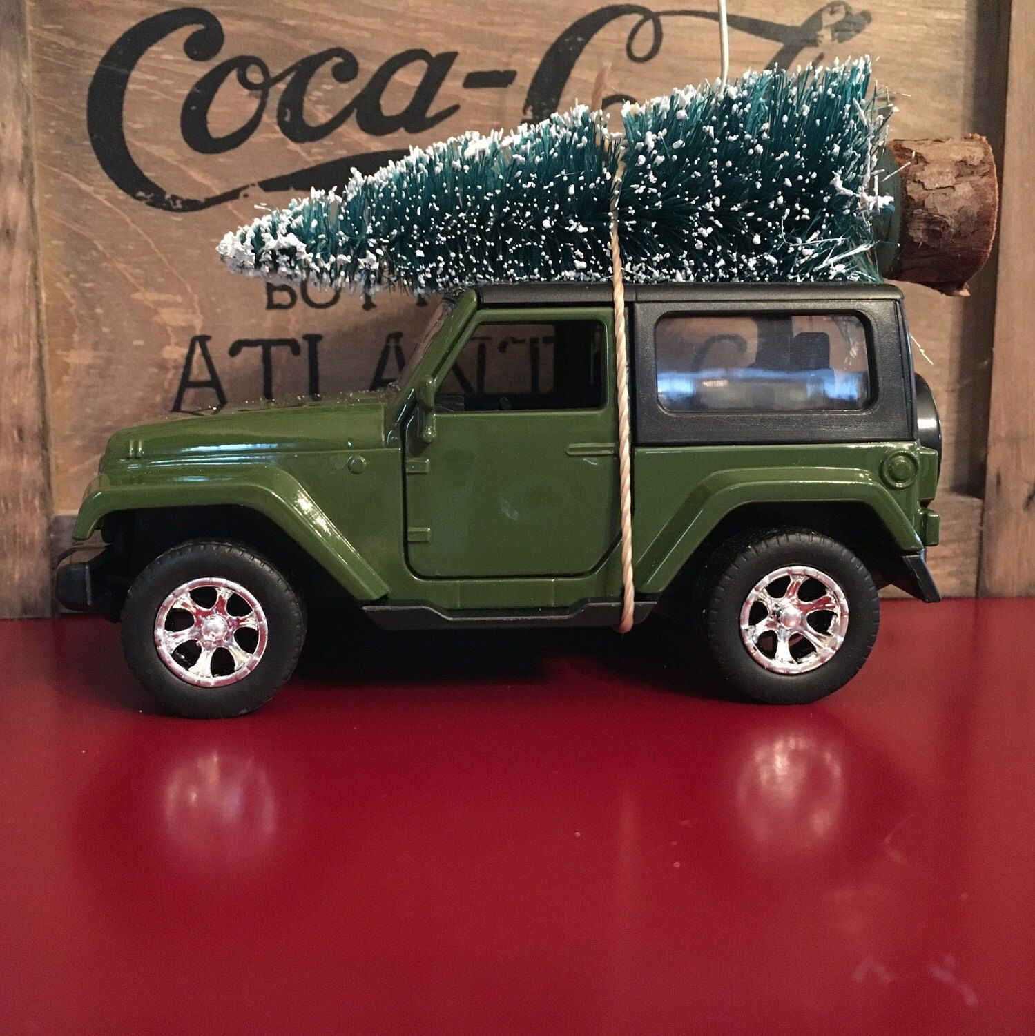 Green Jeep Wrangler Carrying Christmas Tree Ornament