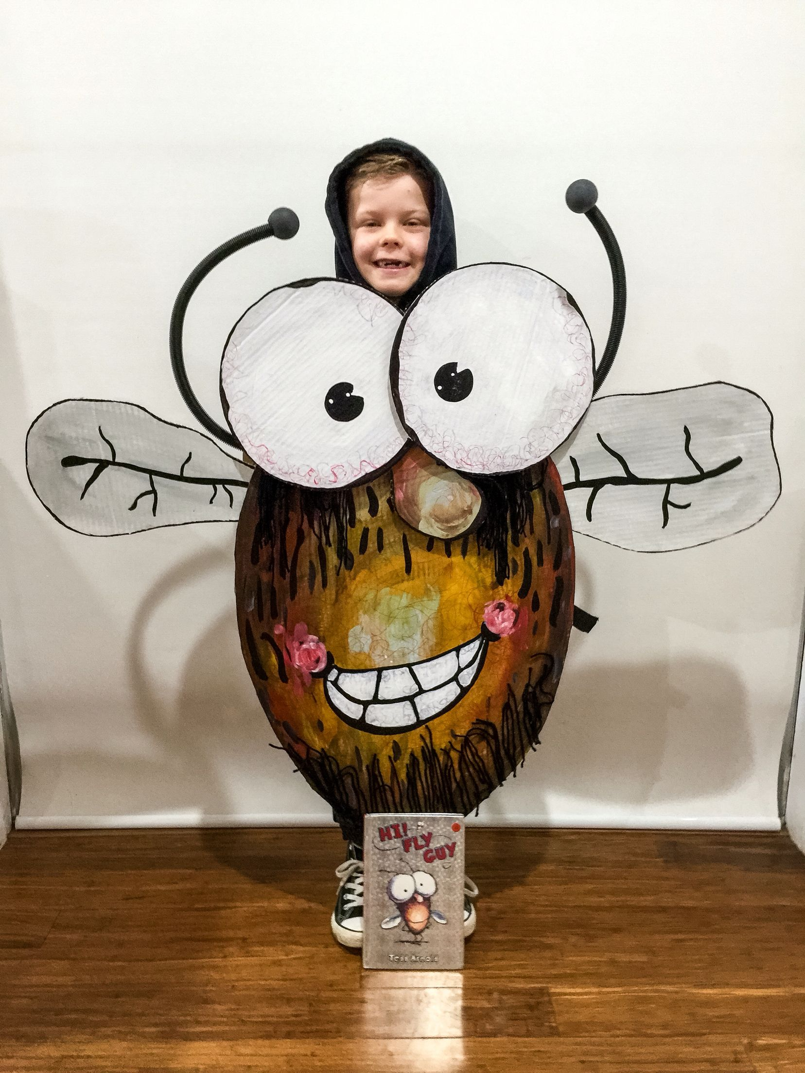 School Book Parade Costume idea. Fly Guy costume for Book week! Made from Cardboard, acrylic paint, black wool, rubber tube and 2 pingpong balls!
