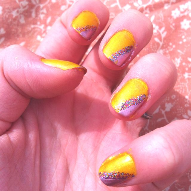 Yellow pink and glitter nails