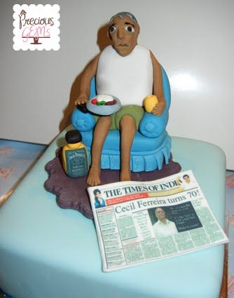 70th Birthday cake with edible cake topper man sitting on a couch