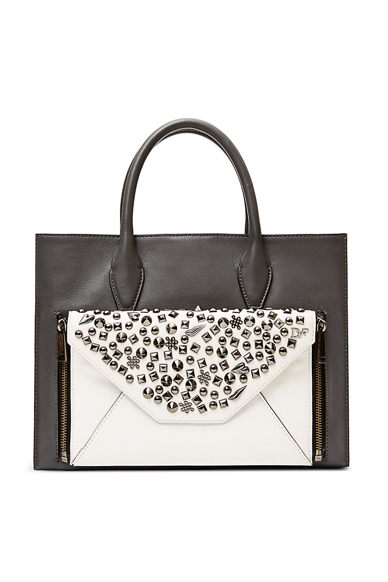 86cd1509d1d7 Customize your DVF Secret Agent tote with the Agent Selena zip on clutch.  In studded black leather, Agent Selena adds an edge. Fits on either tote  size, ...