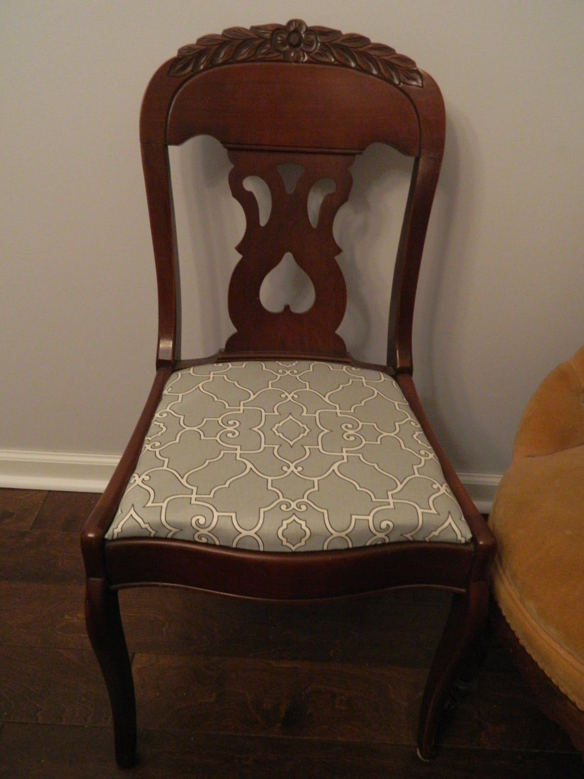 New upholstery on our dining chairs- how we did it... click through to the blog.