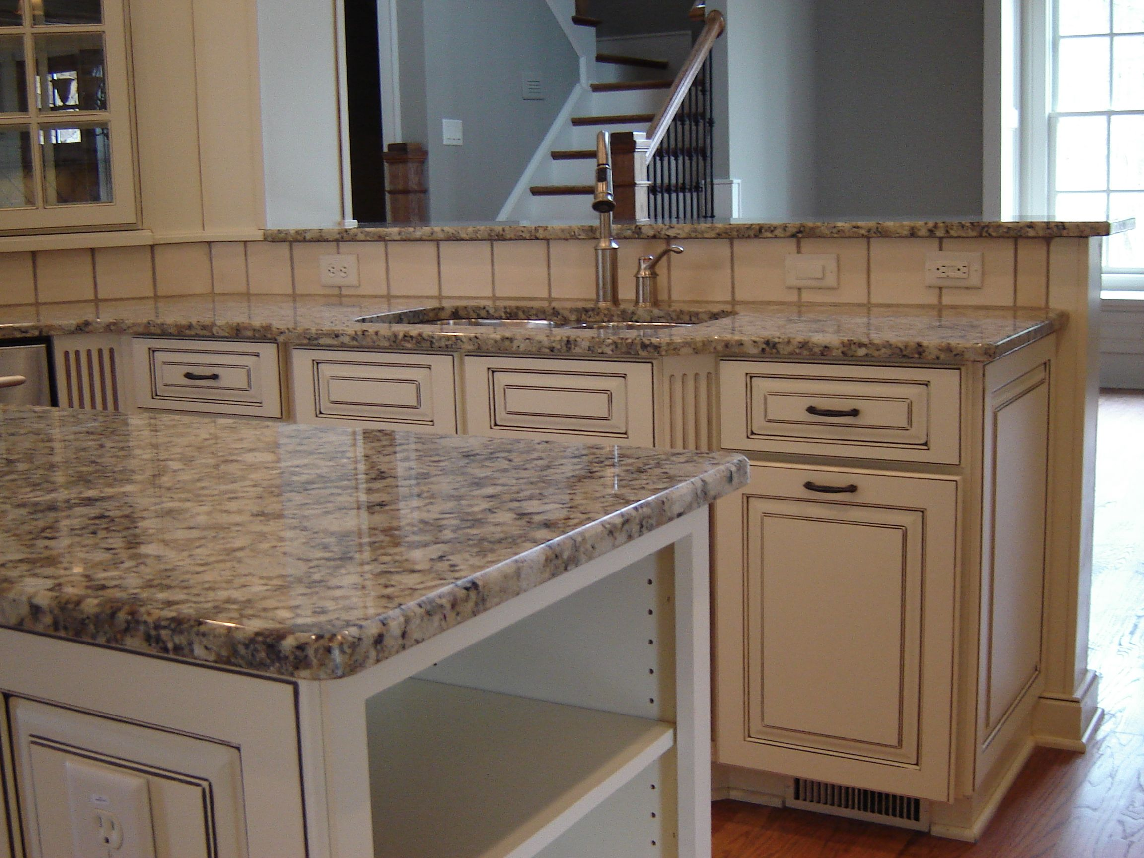 granite marble quartz countertops kitchen remodeling atlanta Dove White cabinets with taupe glaze Gallo Napoleone granite counters Recent project Atlanta