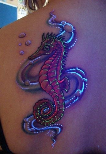 UV Ink Sea Horse Tattoo. thats just awesome
