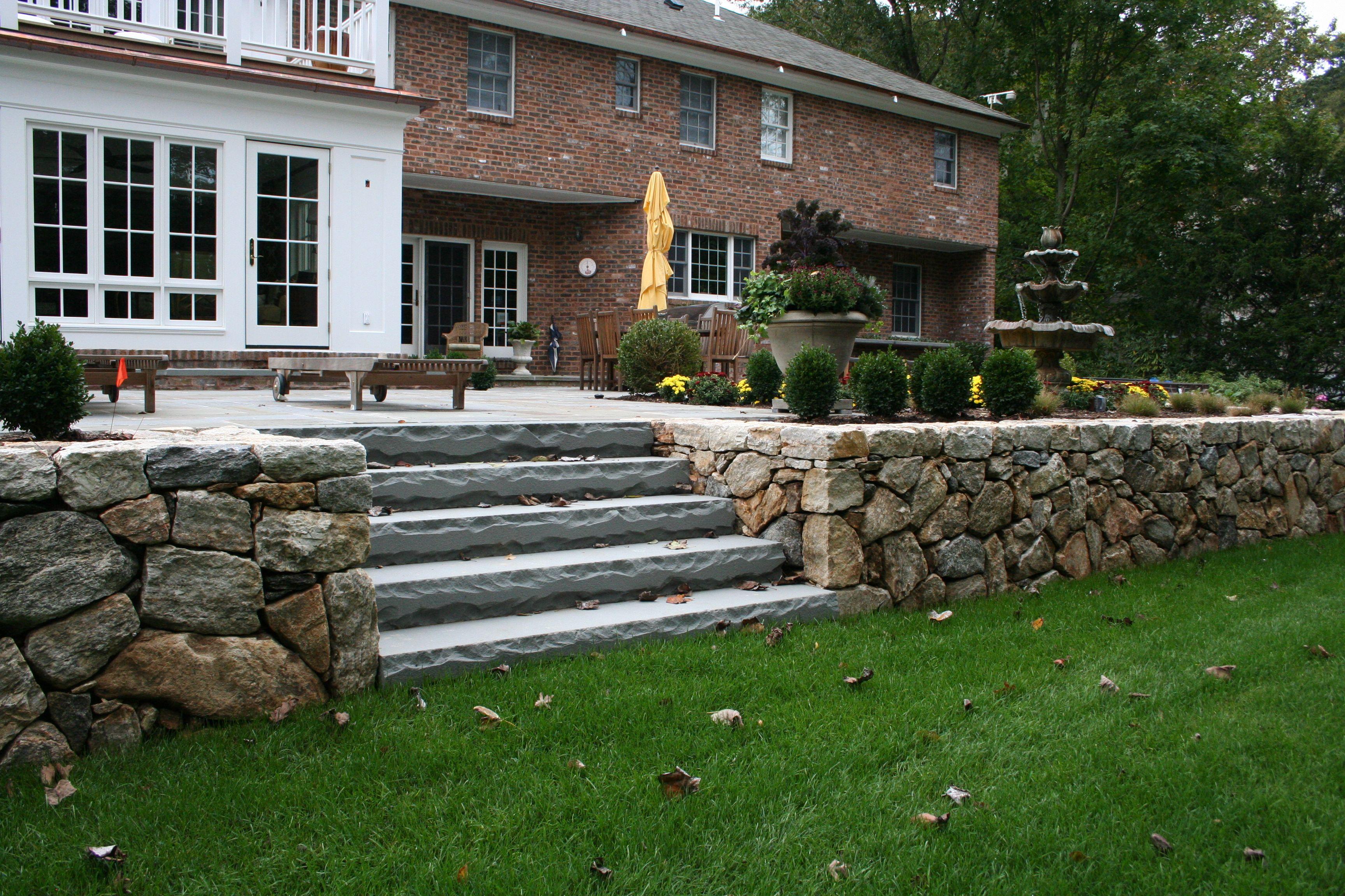 karney stone wall with bluestone steps set in lawn