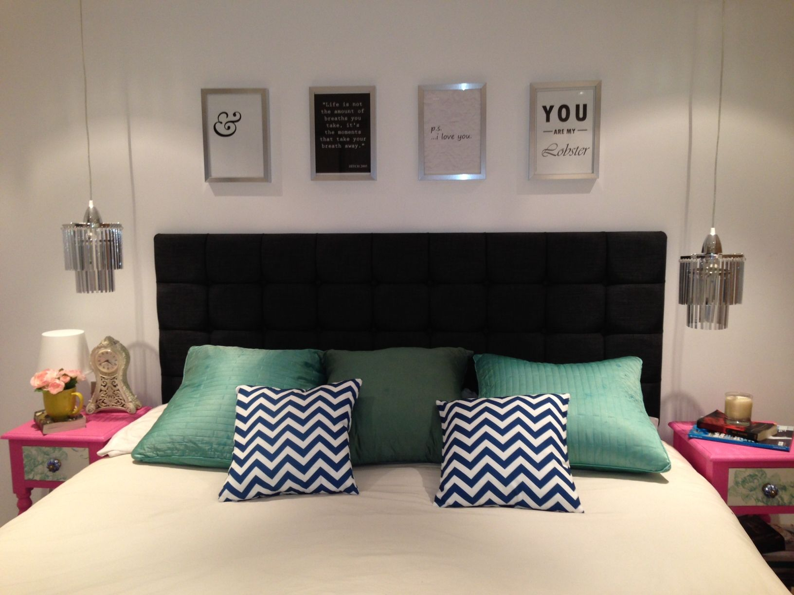 Bedroom update homemade wall art above bed blue chevron cushions