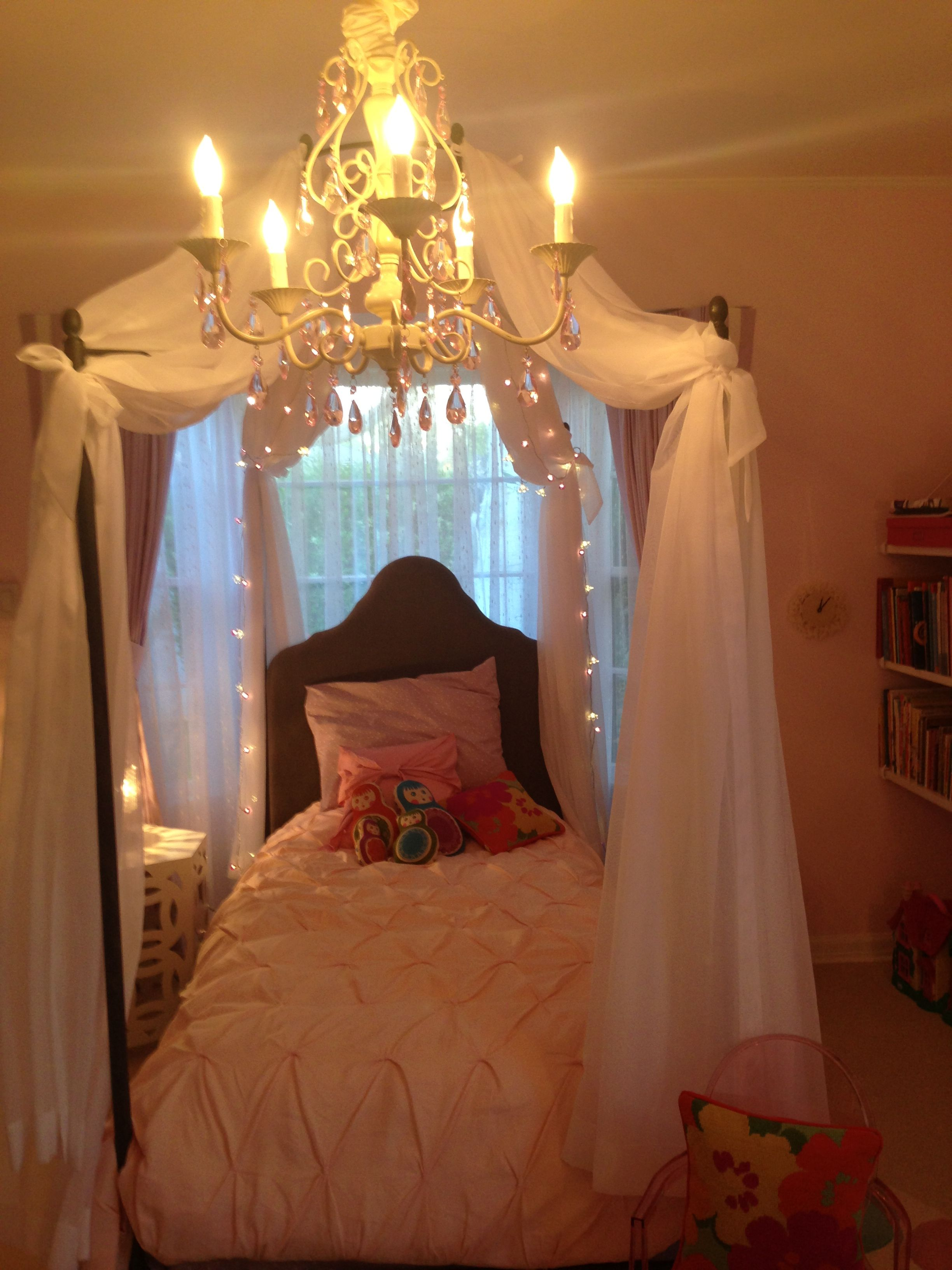 Kid's four poster bed.