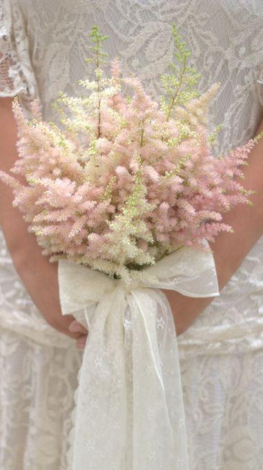 Astilbe wedding bouquet soft pastel pink fluffy florals & lace bound bouquet. Created by Blush Rose Manchester wedding florist. #astilbebouquet