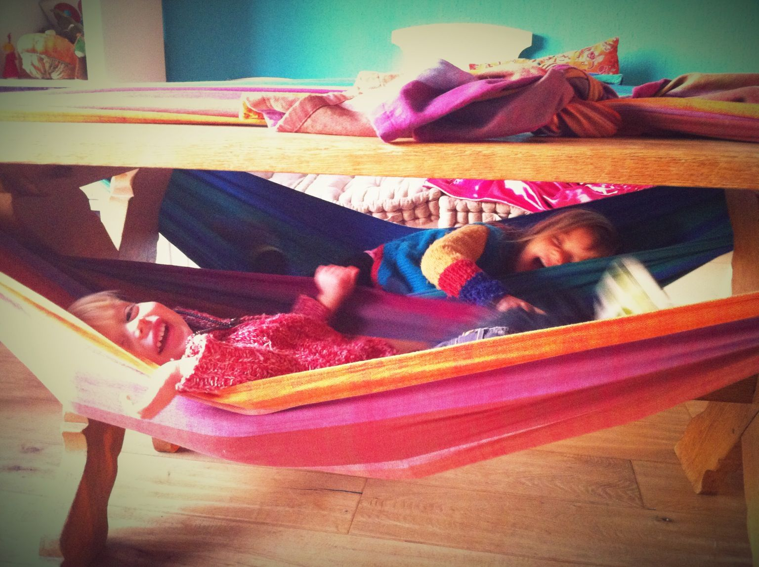 Indoor hammock bed for kids - Indoor Hammock Made Of Woven Wraps Under The Dinner Table
