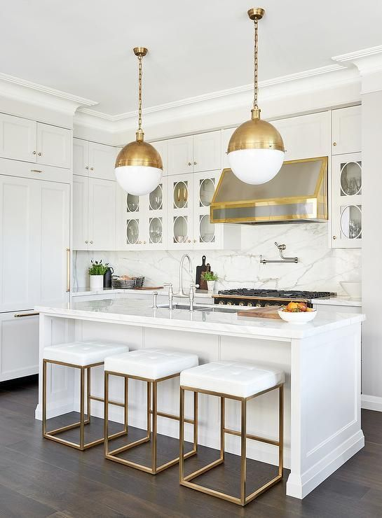 Stunning White Marble Kitchen Displaying Hicks Pendants Over A