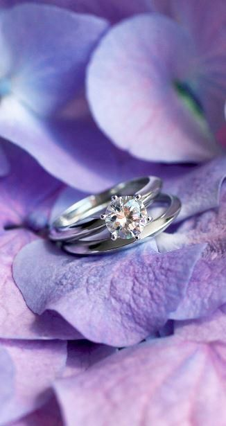 This traditional matched set features a classic six-prong engagement setting with a matching wedding ring.